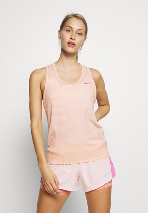 W NK INFINITE TANK - Sports shirt - washed coral