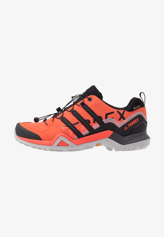 TERREX SWIFT R2 GORE-TEX - Trail running shoes - glow amber/core black/solar red