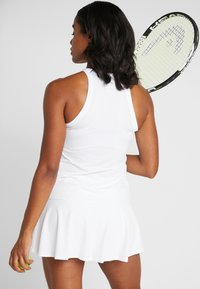 Nike Performance - DRY TANK - Treningsskjorter - white/black - 2