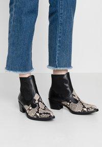 Unisa - GENIL - Ankle boots - black - 0