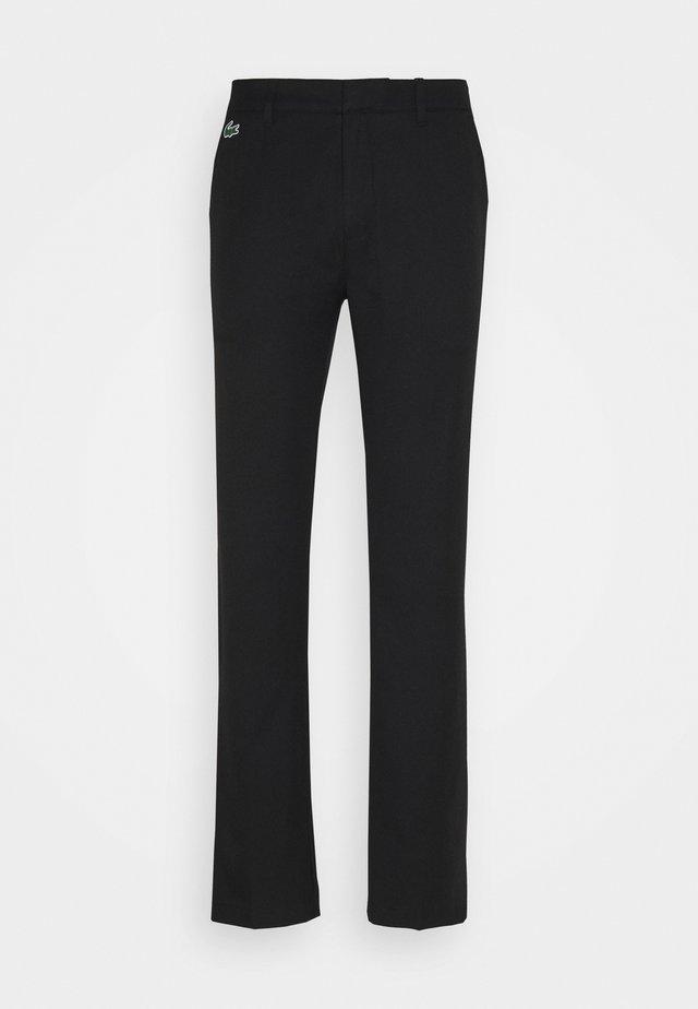 GOLF CHINO - Pantalon classique - black