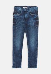 Calvin Klein Jeans - TAPERED - Slim fit jeans - denim - 0