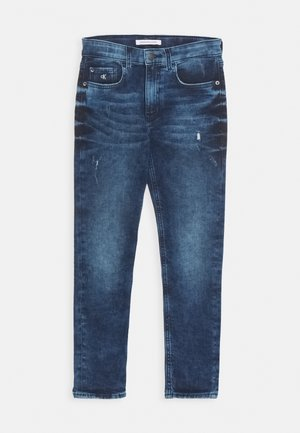 TAPERED - Slim fit jeans - denim