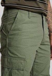 Carhartt WIP - REGULAR COLUMBIA - Cargo trousers - dollar green rinsed - 3