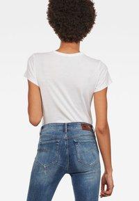 G-Star - GRAPHIC LOGO SLIM - T-shirt print - white - 1