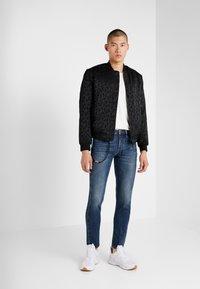 Emporio Armani - BLOUSON - Light jacket - nero - 1