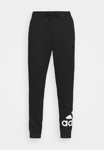 ESSENTIALS - Pantaloni sportivi - black/white