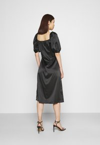 NA-KD - PUFF SLEEVE CUT OUT DRESS - Cocktailkjole - black - 2