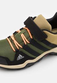 adidas Performance - TERREX AX2R UNISEX - Hiking shoes - wild pine/core black/screaming orange - 5