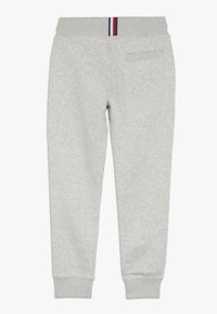 Tommy Hilfiger - ESSENTIAL - Tracksuit bottoms - grey - 1