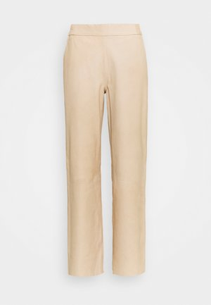 PANTS - Leather trousers - dark vanilla
