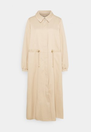 CRHERIA  - Trenchcoat - sesame