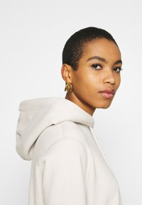 Abercrombie & Fitch - GEL LOGO SNAP POPOVER - Hoodie - cream - 3