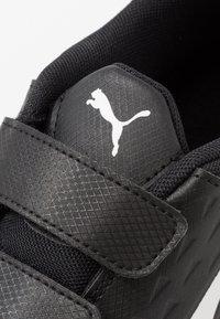 Puma - AURIZ V JR UNISEX - Sports shoes - black/white - 5