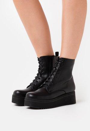 VEGAN TETSU - Platform ankle boots - black
