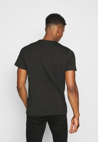 Tommy Jeans - T-shirt basic - black - 2
