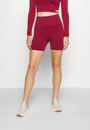 STHLM SEAMLESS SHORTS - Leggings - biking red