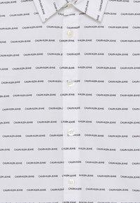 Calvin Klein Jeans - LOGO ALL OVER - Shirt - white - 2