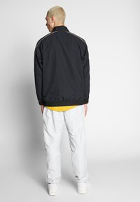Nike Sportswear - TOP - Windbreakers - black/black - 2
