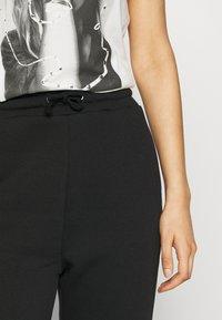 Even&Odd - HIGH WAIST LOOSE FIT SWEAT PANTS - Tracksuit bottoms - black - 4