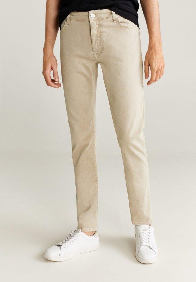 PATRICK - Slim fit jeans - beige