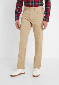 Polo Ralph Lauren - VARICK - Trousers - luxury tan - 0