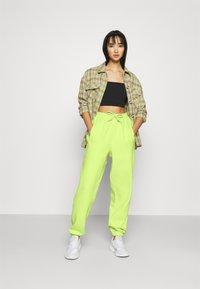 adidas Originals - PANT - Tracksuit bottoms - semi frozen yellow - 1