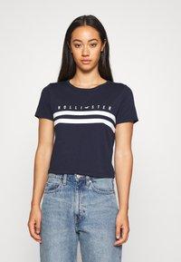 Hollister Co. - TUCKABLE SPORTY - Print T-shirt - navy - 0
