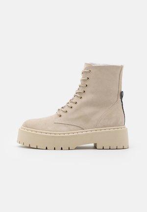 SKYLAR - Platform ankle boots - beige