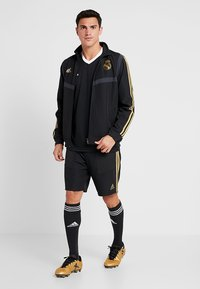 adidas Performance - REAL MADRID - Sports shorts - black/dark gold - 1