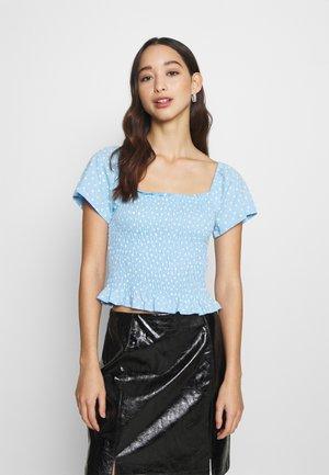 RIVA  - T-shirt z nadrukiem - blue irrydot
