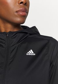 adidas Performance - OWN THE RUN - Training jacket - black - 5