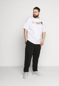 Calvin Klein - LOGO EMBROIDERY - Pantaloni sportivi - black - 1