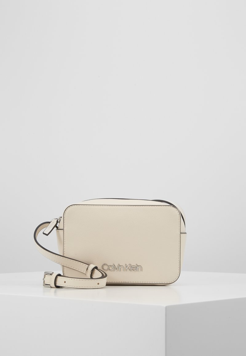 Calvin Klein - CAMERABAG - Across body bag - beige