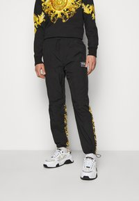 Versace Jeans Couture - CRINKLE  - Tracksuit bottoms - black - 0