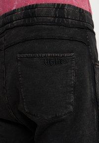 Tigha - GILIAN - Tracksuit bottoms - vintage black - 4