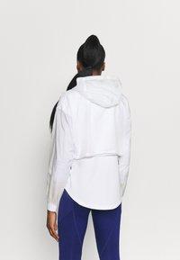 Puma - TRAIN ULTRA HOODED JACKET - Training jacket - puma white - 2
