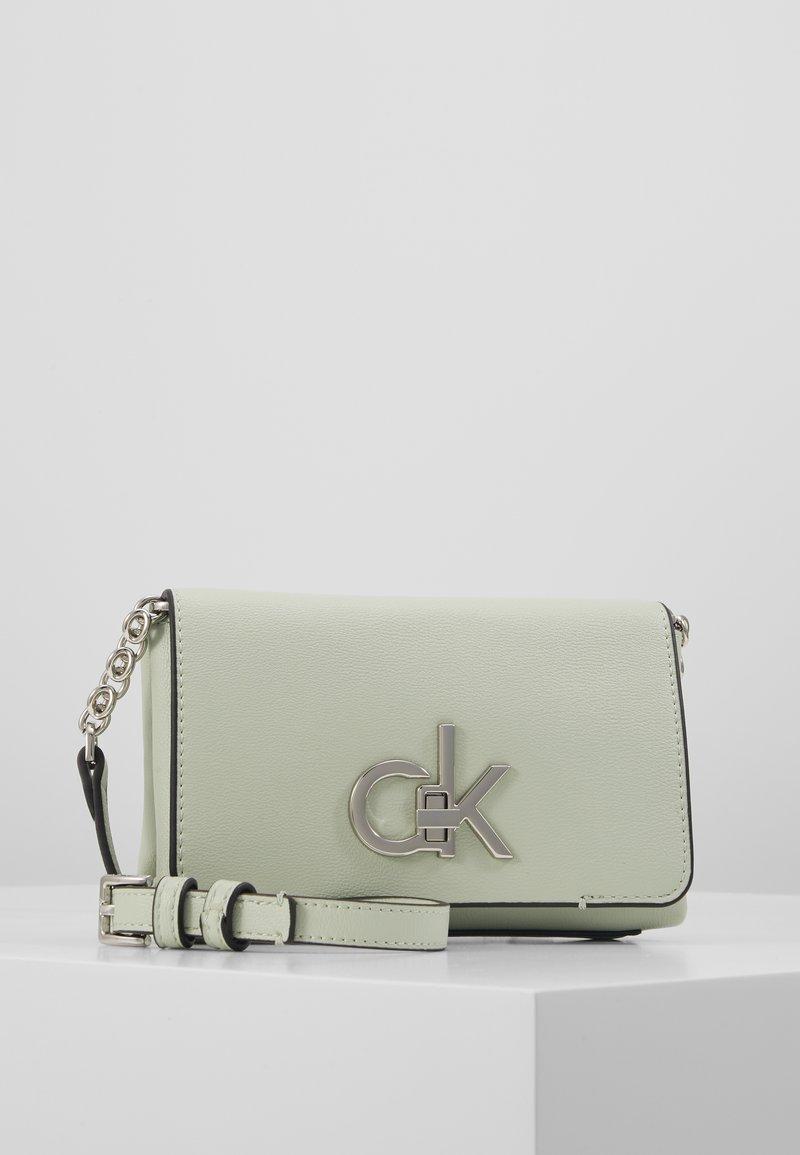Calvin Klein - RE-LOCK FLAP CROSSBODY  - Across body bag - green