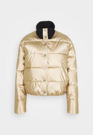 CROSS STEPPING - Winter jacket - gold