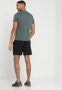 Reebok - WOR SPEEDWICK TRAINING SHORTS - Sports shorts - black - 2