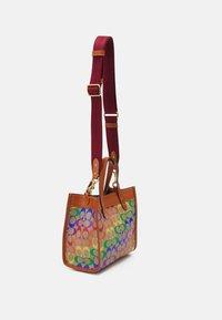 Coach - PRIDE SIGNATURE TOTE - Handbag - tan natural/multi - 1