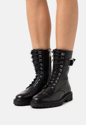 JAUDIE - Bottines à lacets - black