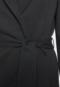 Vero Moda Curve - VMVERODONNA TRENCHCOAT CURVE - Zimní kabát - black - 2