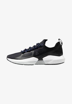 SOLE FURY TS - Sports shoes - black/white