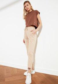 Trendyol - Tracksuit bottoms - brown - 0