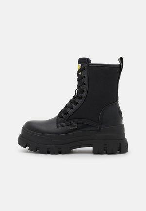 VEGAN ASPHA  - Kotníkové boty na platformě - black