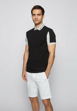 PAVEL - Polo shirt - black