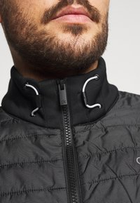 Calvin Klein Golf - WRANGELL HYBRID GILET - Waistcoat - black - 4