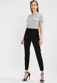 Vero Moda - VMEVA LOOSE STRING PANTS - Bukser - black - 1