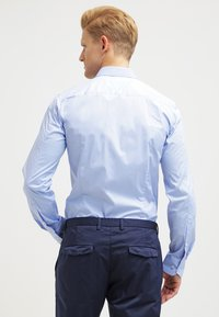 HUGO - ELISHA EXTRA SLIM FIT - Formal shirt - light/pastel blue - 2